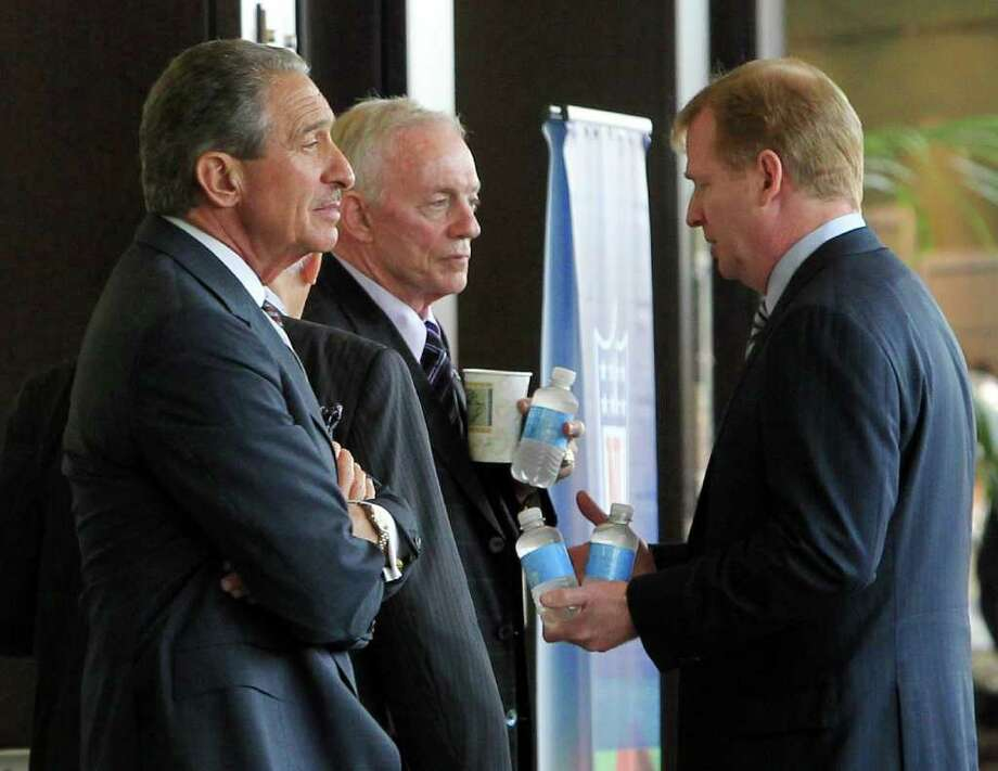 Atlanta Falcons owner Arthur Blank, from left, Dallas Cowboys owner Jerry Jones, and NFL Commissioner Roger Goodell have a conversation in the hallway outside the NFL owners meeting at the Atlanta Airport Gateway Marriott in Atlanta, Georgia, Thursday, July 21, 2011. (Curtis Compton/Atlanta Journal-Constitution/MCT) Photo: Curtis Compton, MBR / Atlanta Journal-Constitution