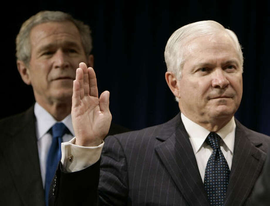 President Bush watches as Defense Secretary Robert Gates is sworn in by Vice President Dick Cheney during a ceremony at the Pentagon today. Photo: RON EDMONDS, AP