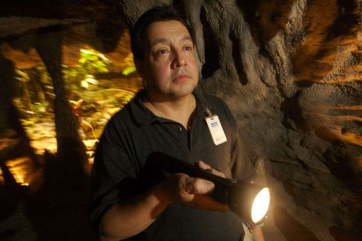 John Longoria, security guard at the Houston Museum of Natural Science, gets ready to lock up the facility for the night.