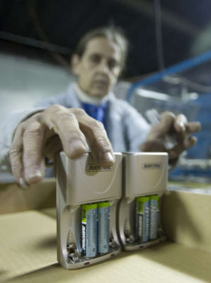 Dorothy Beaster prepares Rayovac Hybrid batteries to be packaged in Palmyra, Wis. Battery makers are pushing improvements in rechargeable batteries. Photo: Morry Gash, AP