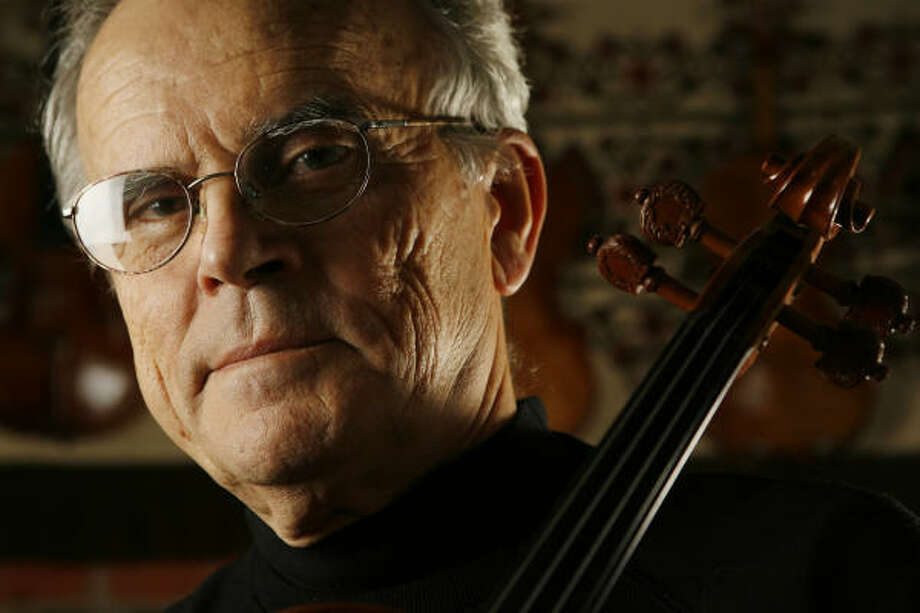 Texas A&M professor emeritus Joseph Nagyvary said he studied the construction of Antonio Stradivari's violins for decades before identifying a treatment to repel worms as the source of their famous sound. He now uses the compound on the violins he makes in College Station. Photo: Kevin Fujii, Chronicle