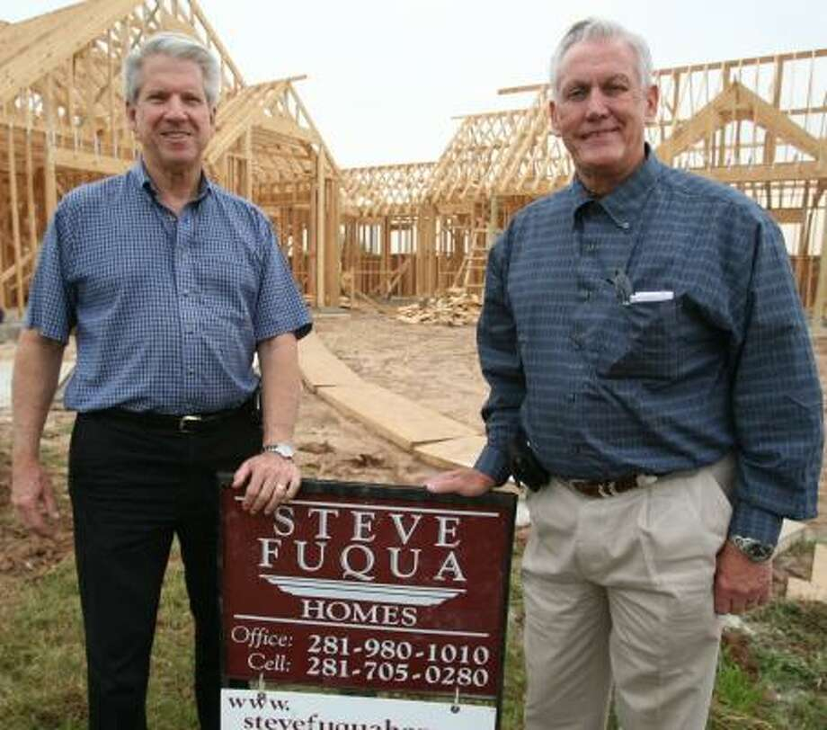 Dan Roth, left, has worked with Steve Fuqua for 27 years — 12 years as partners. Fuqua is celebrating 30 years of building homes in Fort Bend County. Photo: SUZANNE REHAK, FOR THE CHRONICLE