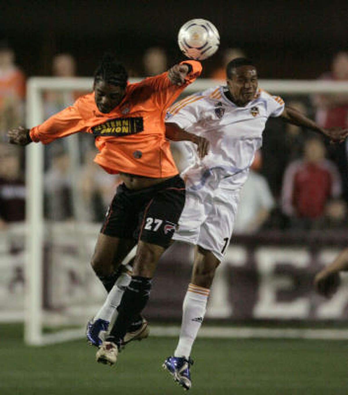 Houston Dynamo midfielder Ricardo Clark, right, battles Puntarenas FC's Max Sanchez in a March soccer match in College Station. Clark and the Dynamo may get a new stadium under a plan being negotiated by the team and Houston.