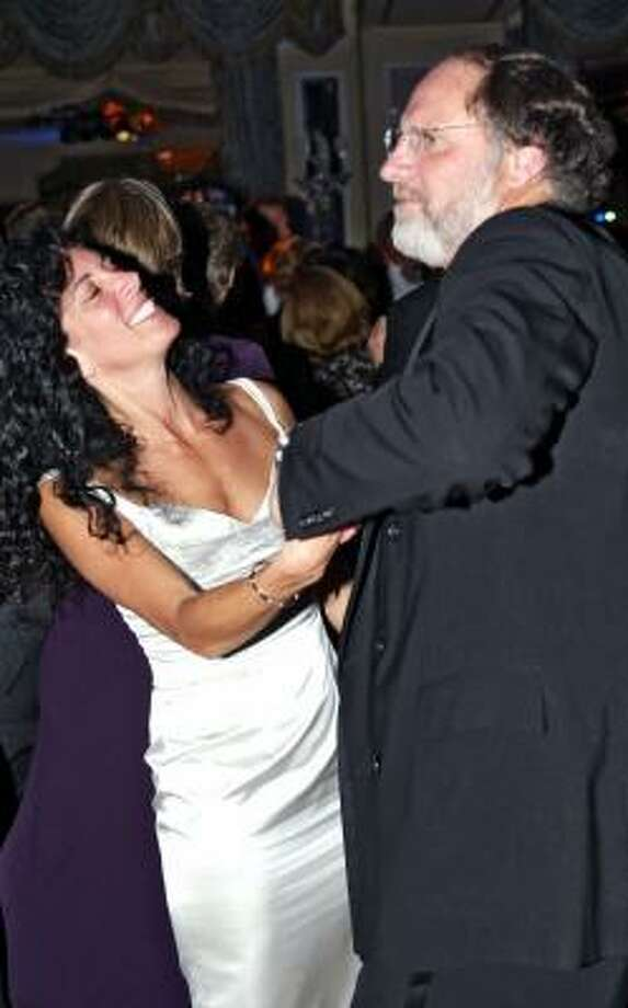 Then-Sen. Jon Corzine dances with Carla Katz at a 2002 charity ball in New York. Photo: RICK BARD, Associated Press File