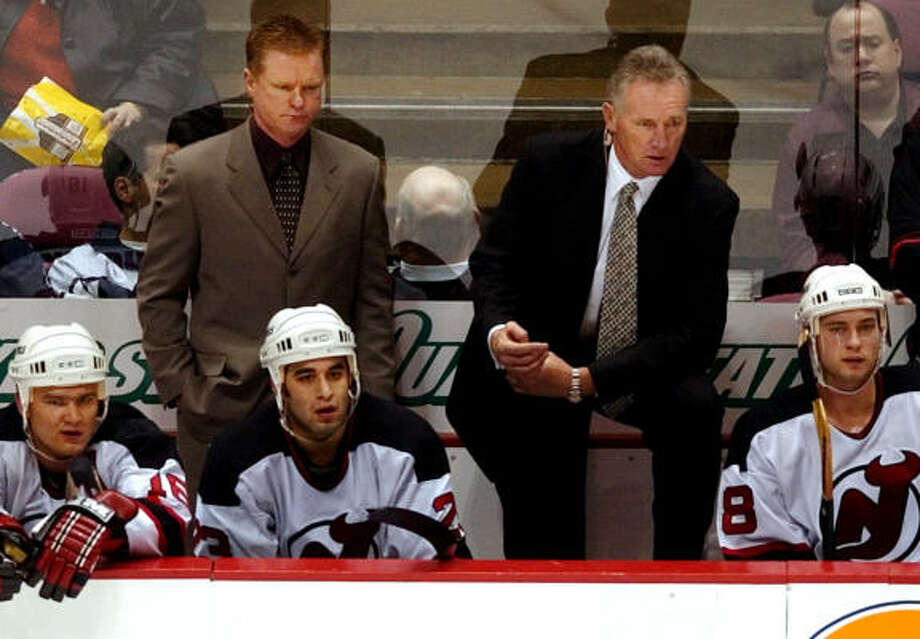 Kevin Constantine, top left, counts the New Jersey Devils among his NHL stops. Photo: BILL KOSTROUN, AP