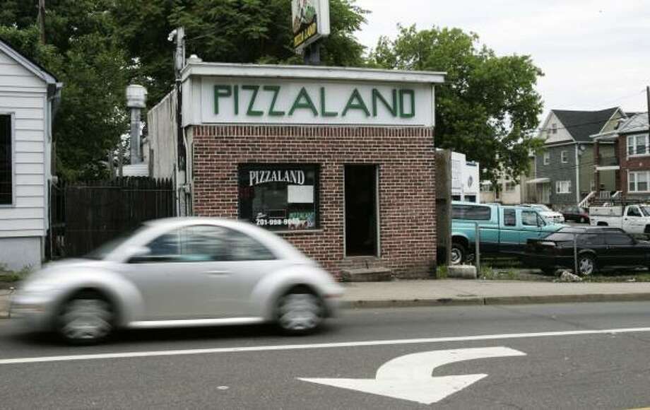 The tiny Pizzaland pizza parlor in North Arlington, N.J., that was seen in the opening credits of The Sopranos is still enjoying a surge in business two weeks after the series finale. Photo: Mike Derer, ASSOCIATED PRESS