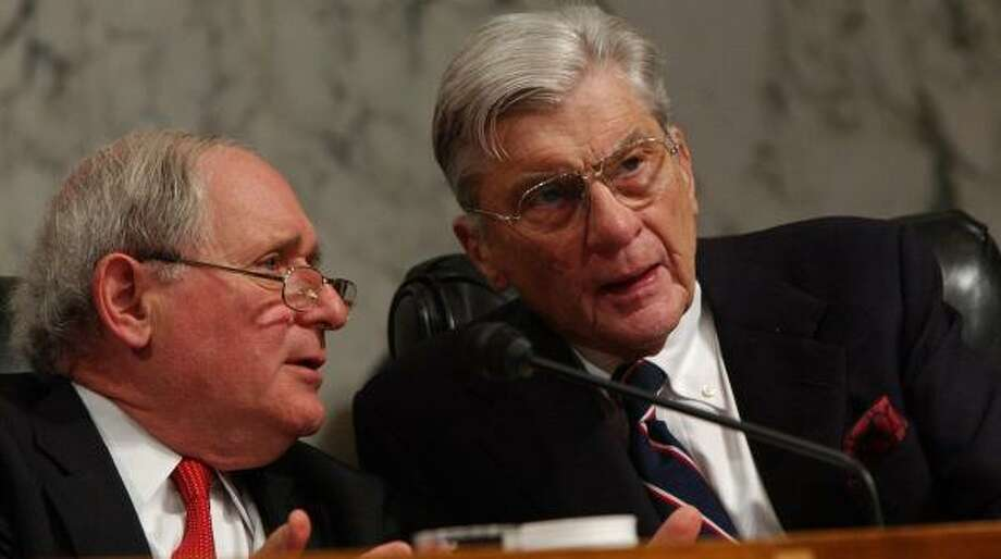 Senate Armed Services Committee Chairman Sen. Carl Levin, D-Mich., left, and Sen. John Warner, R-Va., at a committee meeting in June. Warner is putting off questions about re-election plans. Photo: DENNIS COOK, ASSOCIATED PRESS