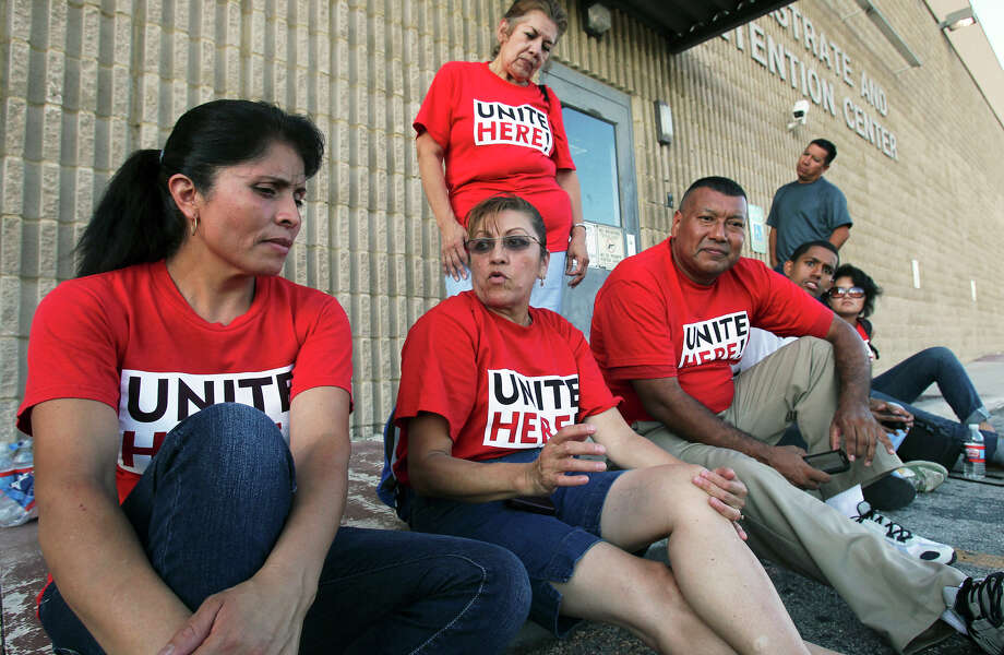Elvia Claudio (left), whose daughter Perla Terrazas was arrested, waits with other Hyatt workers demonstrating at the magistrate's office in the late afternoon on Thursday. The workers moved their demonstration to the law enforcement center after some of their ranks were arrested. Talking with Claudio (from left) are Maria Soto, Daniel Ovalle, Jonathan St. Mary, Emma Hernandez and Ana Esparza (top). TOM REEL/treel@express-news.net