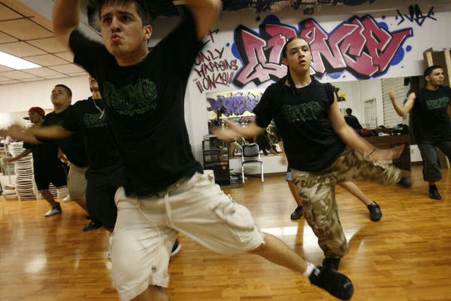 Chris Quintanilla, left, and Brandon Lomeli and others practice routines before they begin quinceañera
