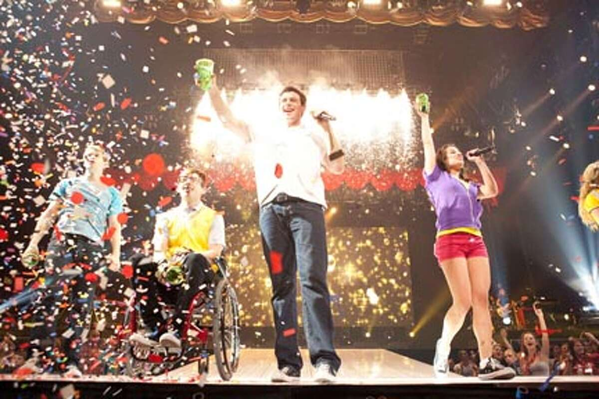 """(L-R) Chord Overstreet as Sam Evans, Kevin McHale as Artie Abrams, Cory Monteith as Finn Hudson and Lea Michele as Rachel Berry in """"Glee the 3D Concert Movie."""""""