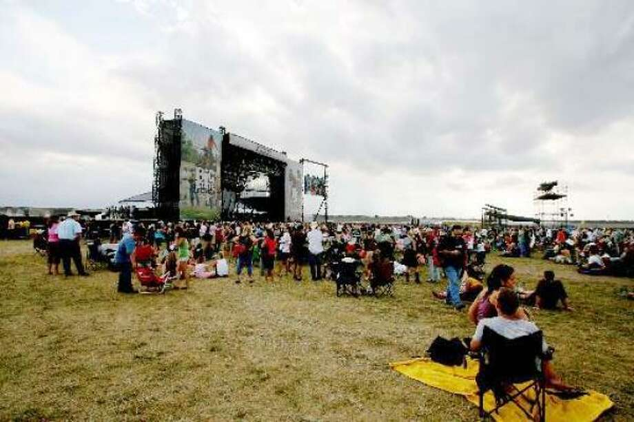 The Tundra stage draws fans despite some cloudy skies Sunday over the first Big State Festval at Texas World Speedway in College Station. Photo: Bill Olive, For The Chronicle