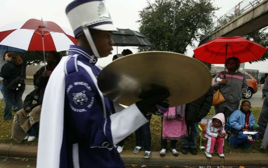 Residents braved afternoon showers to watch band members from Wheatley High School march down Allen Parkway on Monday during the MLK Parade Foundation's 14th Annual MLK Grande Parade. Photo: SHARÓN STEINMANN, CHRONICLE