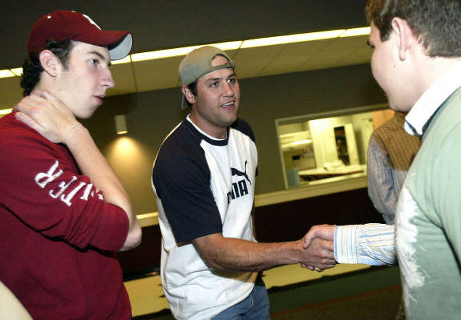 "Astros first baseman Lance Berkman meets with Stuart Slattery, left, and Tim Hancock at Bethel Independent Presbyterian Church in Houston. The slugger is serving as a speaker in a six-week Bible study ""for high school guys."" Photo: Jessica Kourkounis, For The Chronicle"