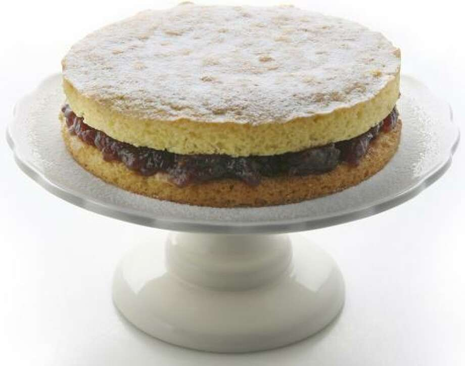 A queenly Victorian sandwich cake can be dressed up for any occasion, but it's possibly best in its simplest form. Photo: JULIA EWAN, WASHINGTON POST