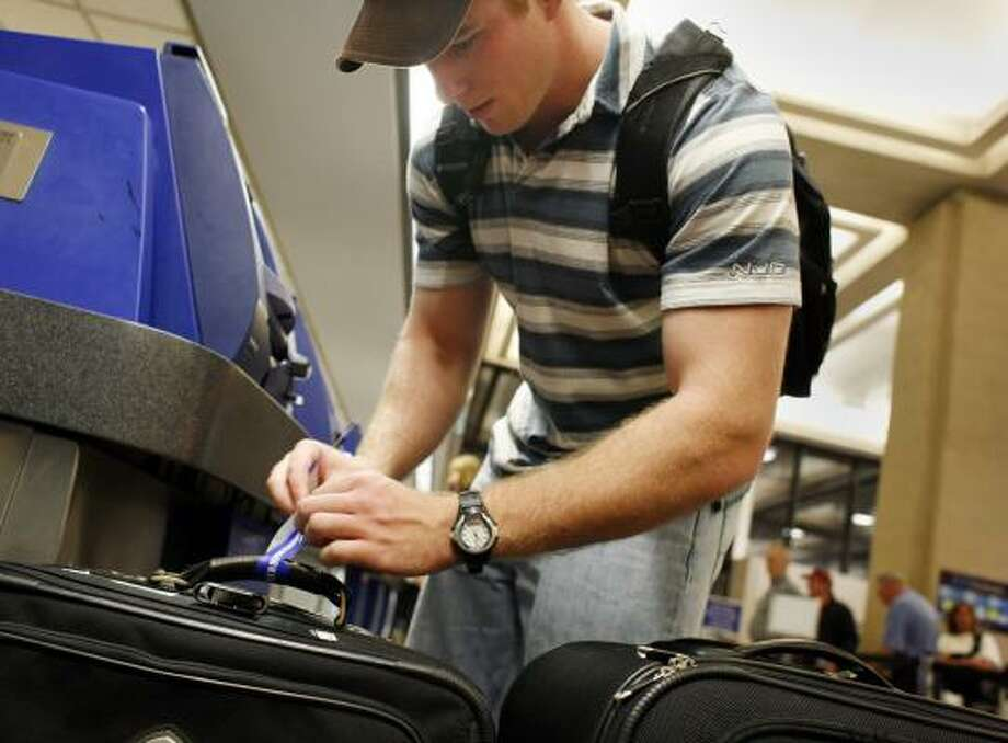 Walter Brinker, at George Bush Intercontinental on Friday, didn't have to pay for a second bag on Continental. But on May 5 some travelers will pay more for their extra luggage. Photo: ERIC KAYNE, CHRONICLE