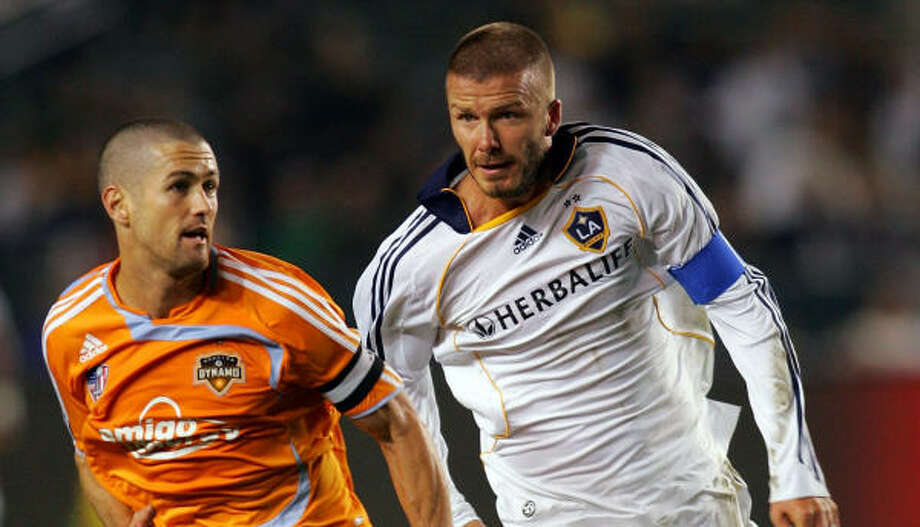 L.A. Galaxy midfielder David Beckham, right, proved to be too much for the Dynamo to handle in Saturday's match. Photo: Victor Decolongon, Getty Images