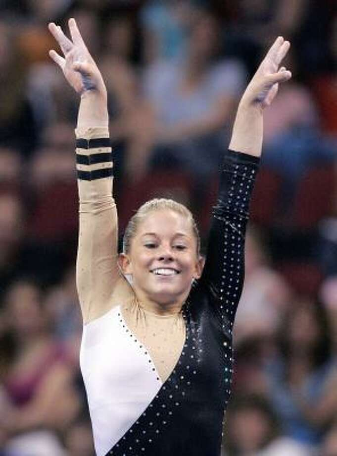 Shawn Johnson finishes her floor routine with a flourish en route to winning her second consecutive title at the U.S. Gymnastics Championships on Saturday night. Photo: MICHAEL DWYER, ASSOCIATED PRESS