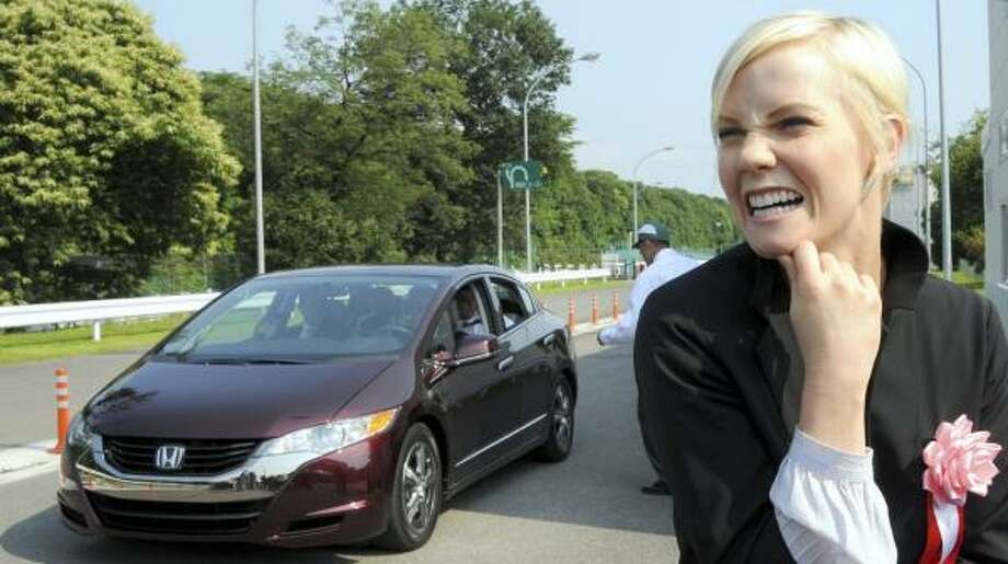 "Actress Laura Harris is one of the first customers of Honda's FCX Clarity hydrogen fuel cell car. ""It's like a future machine,"" she said after a test drive, ""but it's not."" Photo: KATSUMI KASAHARA, ASSOCIATED PRESS"
