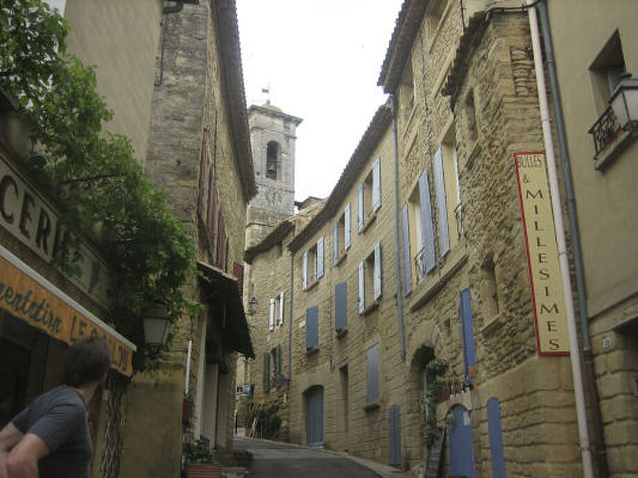 Visitors walk the winding streets in the Rhone Valley village of Châteauneuf du Pape, known for producing some of the region's finest wines. Photo: Corilyn Shropshire, Chronicle