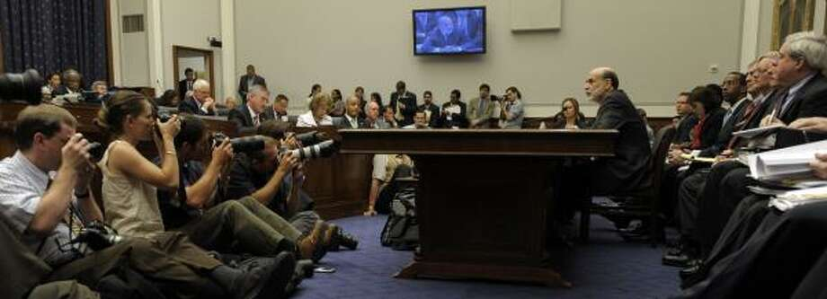 News photographers train their cameras on Ben Bernanke as the Federal Reserve chairman testifies to the House Financial Services Committee on Wednesday. Photo: SUSAN WALSH, ASSOCIATED PRESS