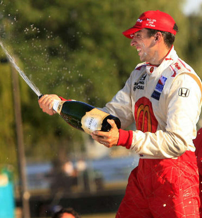 Justin Wilson of McDonald's Racing Team celebrates with champagne. Photo: MANDI WRIGHT, MCT
