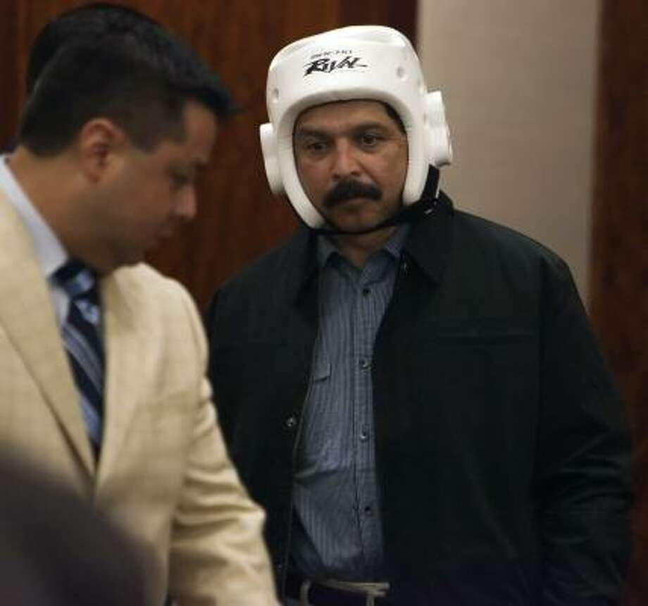 Tejano music star Emilio Navaira, in protective head gear because of severe injuries suffered in the crash of his tour bus, pleaded guilty to DWI in a Houston court. Photo: Sharon Steinmann, Chronicle