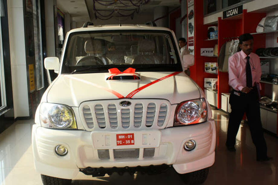 Sport utility vehicles and pickup trucks based on the Mahindra Scorpio, like this one on display in Mumbai, are expected to debut in the U.S. this fall. The manufacturer claims the cleaner-burning diesel engine will get 30 miles per gallon. Photo: PURVA PATEL, Chronicle