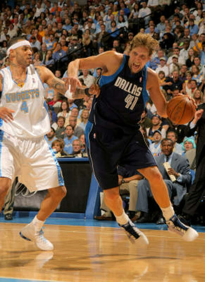 Nuggets forward Martin, left, knocked down Dirk Nowitzki with a shoulder bump when the All-Star tried to go baseline, drawing a technical foul during Game 1 of their best-of-seven second-round playoff series Sunday in Denver. The Nuggets won 109-95. Photo: Doug Pensinger, Getty Images