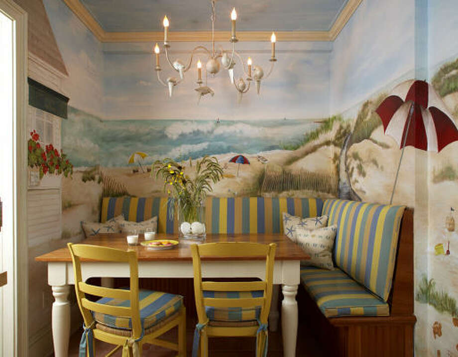 SEASONAL TOUCH: Summer can last all year in a tiny breakfast nook wrapped in a wall-to-wall painted mural.