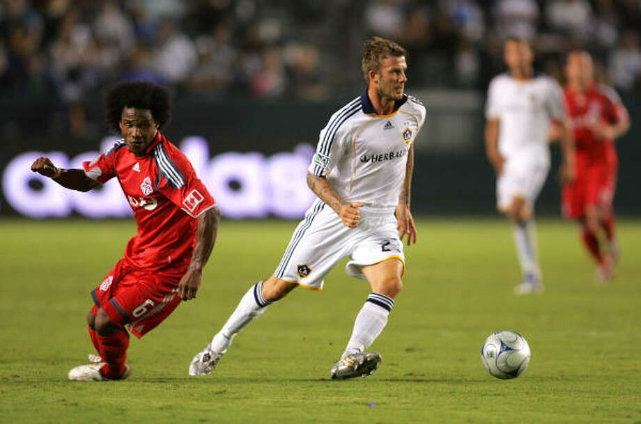 The Galaxy hope David Beckham, right, will have his transfer to Italy for after the MLS season settled soon. Photo: Victor Decolongon, Getty Images