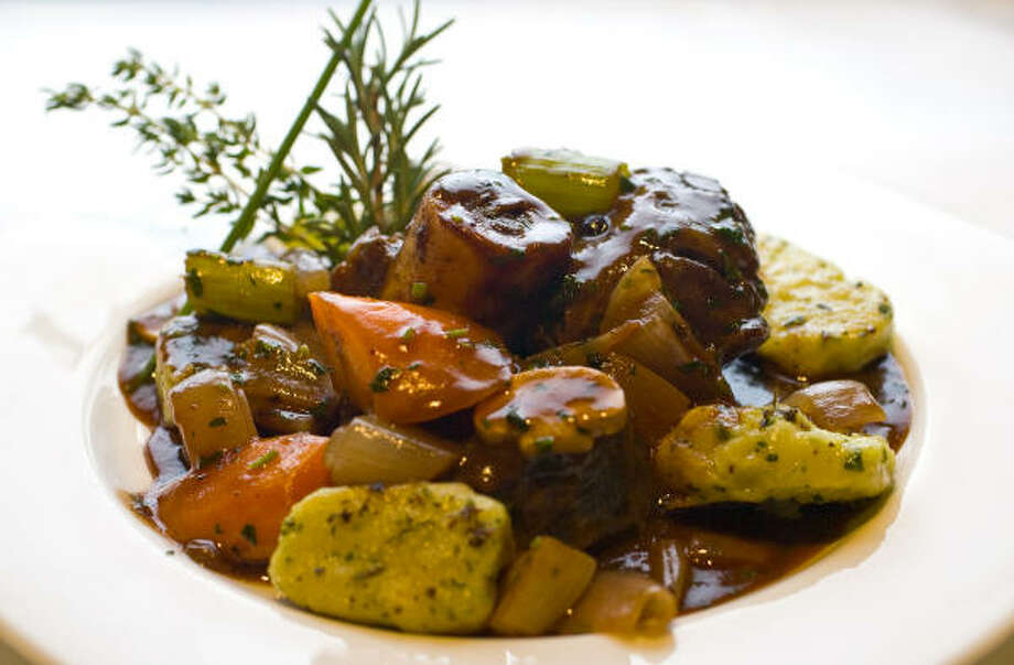 The elk osso buco dish includes rosemary garnish and herbed gnocchi cakes. Photo: Karen Warren :, Chronicle