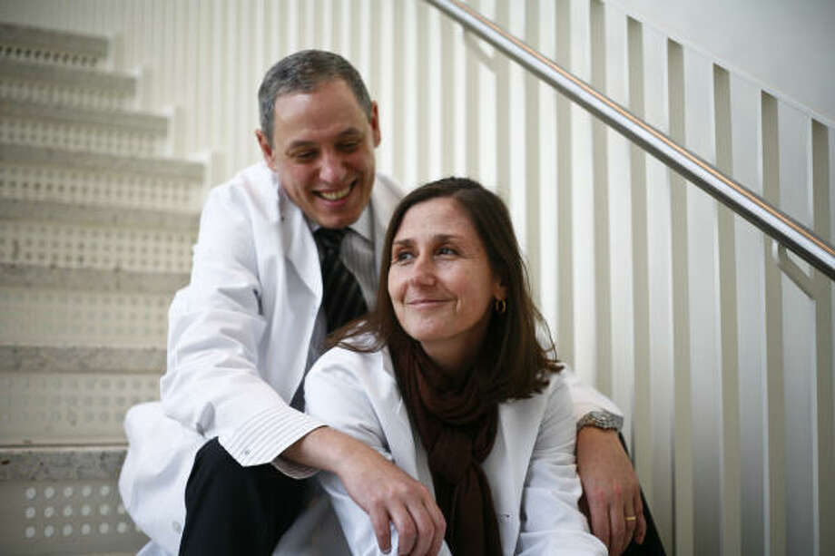 "Wadih Arap and his wife, Renata Pasqualini, now lead a laboratory together at M.D. Anderson. ""He held my hand, and time stopped,'' she said of their brief courtship. Photo: Michael Paulsen, Chronicle"