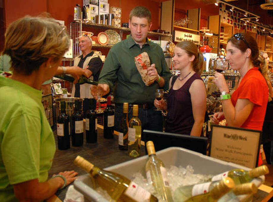 Last year's H-E-B Wine Walk at Market Street featured 30 tasting stations. Like this year, it is just one of the many events during Wine and Food Week. Photo: CHRONICLE FILE