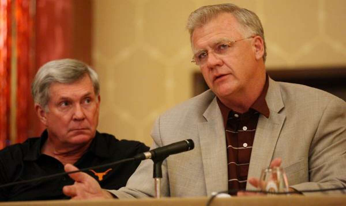 Texas' Mack Brown and Texas A&M's Mike Sherman discussed things other than the fate of the Big 12.
