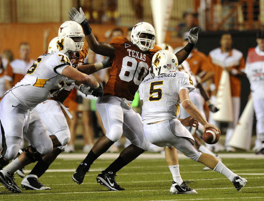 Alex Okafor's shift to defensive tackle might have been UT's best strategic adjustment of the season. Photo: BILLY CALZADA, SAN ANTONIO EXPRESS-NEWS