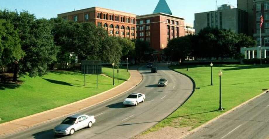 The School Book Depository, at left on Dealey Plaza in Dallas, is believed to be the source of the shots. Photo: ERIC NOLAND, LOS ANGELES DAILY NEWS FILE