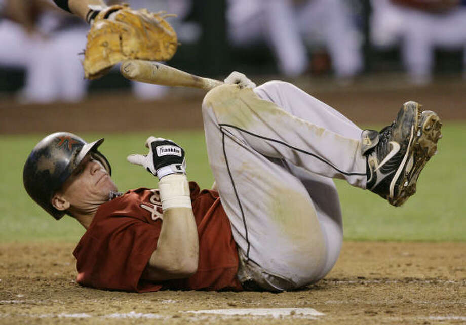The Astros and Craig Biggio have found it hard to find steady footing on the current trip. Photo: Ross D. Franklin, AP