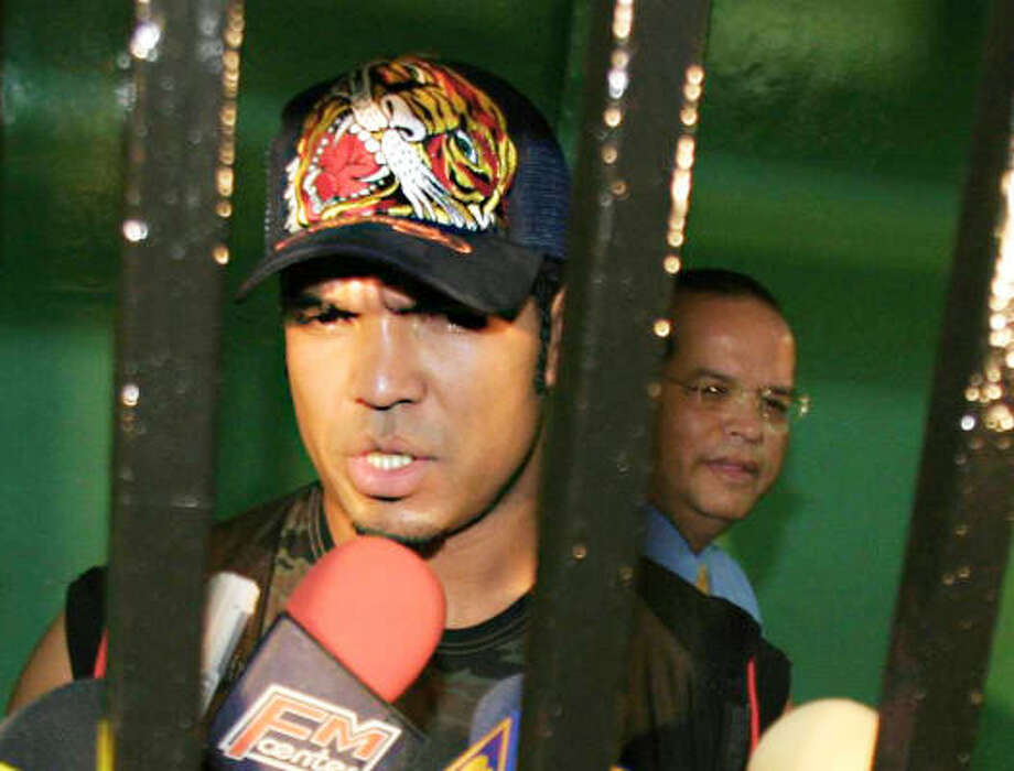 Former Phillies pitcher Ugueth Urbina talks to reporters from behind bars in jail in Caracas, Venezuela, two years ago after being arrested and held prior to attempted murder charges being filed against him. Photo: ALEX DELGADO, AP