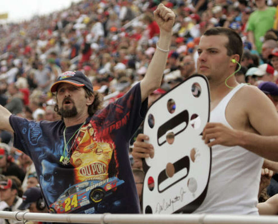Fans Richard Randall, left, and Brent Harrington cheer on the racers at Martinsville, Va. Photo: Steve Helber, AP