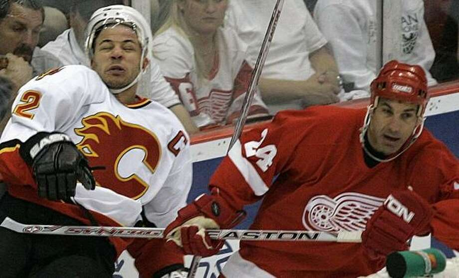 Chris Chelios (right) and Detroit head for Calgary and Game 6 on Sunday with the lead. Photo: Paul Sancya, AP