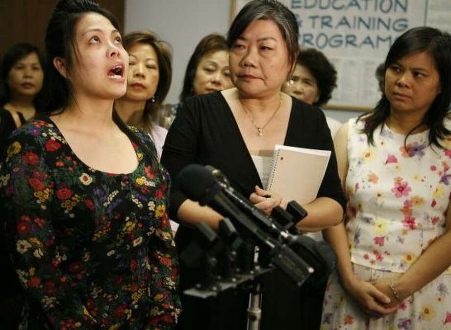 Connie Diep, left, becomes emotional at a news conference Friday concerning the custody battle for her nephew, Raymond Liu. Accompanying her are advocate Kim Szeto, center, and Diep's sister, Ling Liu. Photo: JAMES NIELSEN, CHRONICLE