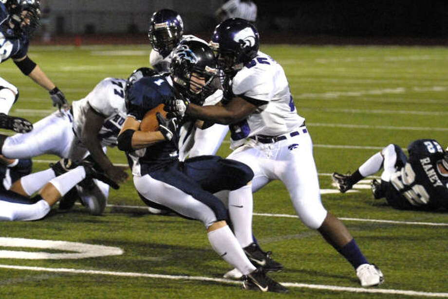 Humble's Robert Parker puts a hit on Kingwood running back Matt Brown during the first half. Photo: Craig Prejean, For The Chronicle