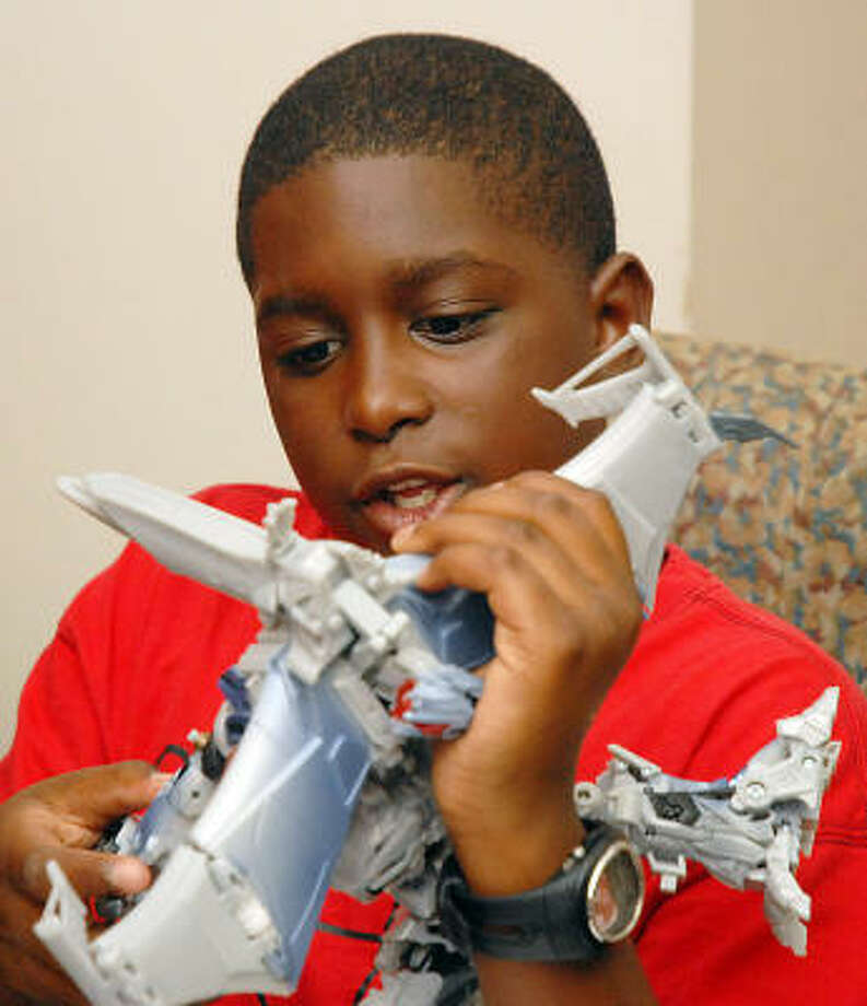 Alvin Richardson, 11, takes on a Megatron challenge. Photo: Dave Rossman, For The Chronicle