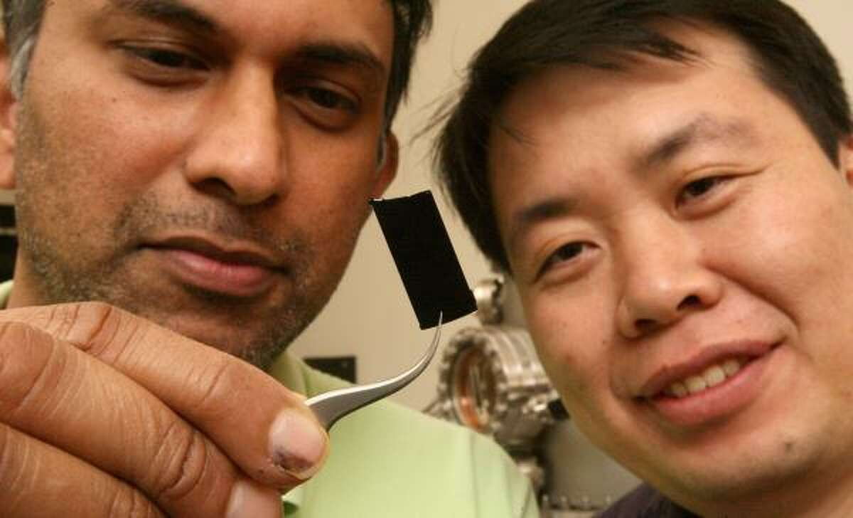 Professor Pulickel Ajayan, left, and Ligie Ci have created the darkest substance on Earth. The material could be used for collecting solar energy or improving telescopes, Ajayan said.