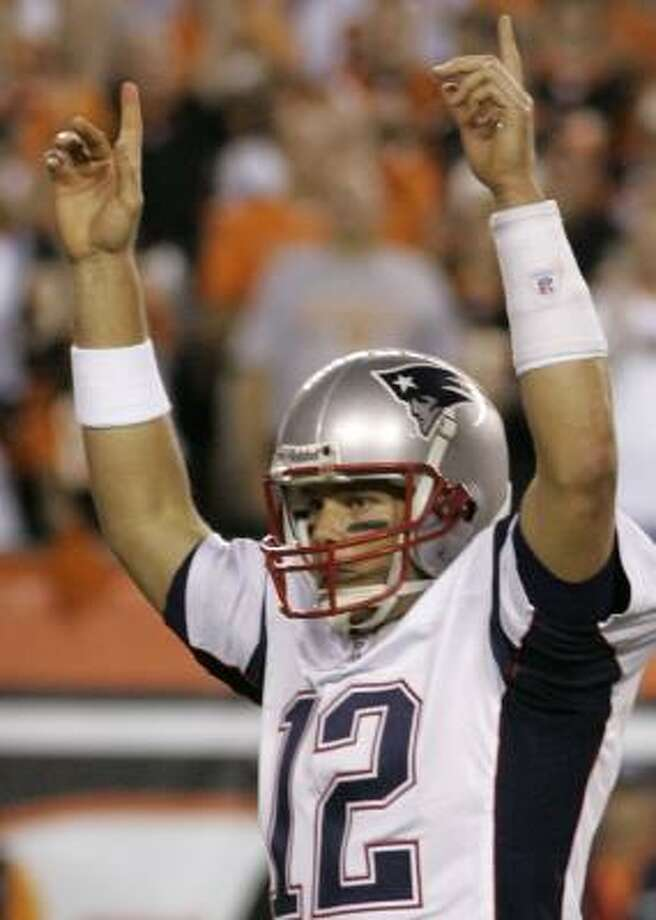 If Patriots quarterback Tom Brady does a lot of this today, the Cowboys will be in trouble. Photo: AL BEHRMAN, ASSOCIATED PRESS