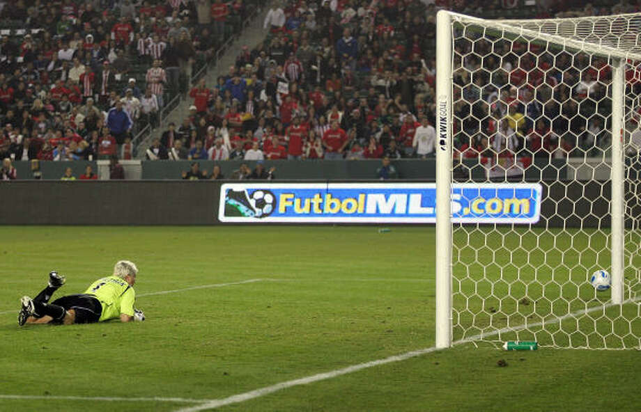 Kevin Hartman has been lucky -- watching this ball bounce off the post in the first-round series against Chivas USA -- and good as the Wizards have recorded three straight shutouts. Photo: Victor Decolongon, Getty Images