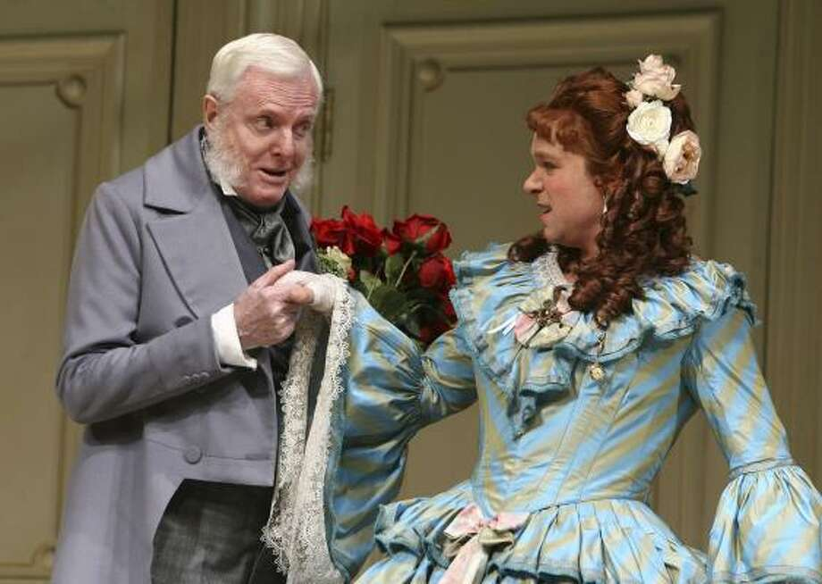 John McMartin as Papa Leroux, greets Norbert Leo Butz portraying Jean-Francois Millet, dressed in drag as the widow Tillou, in Is He Dead?, a new play by Mark Twain showing at The Lyceum Theatre in New York. Photo: Joan Marcus, AP