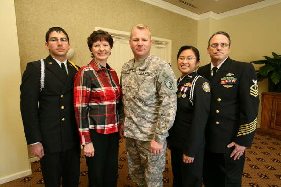 Army Maj. Troy Nehls, 39, center, meets Clements High School students before his Jan. 2 deployment to Afghanistan.  From left, Cadet Executive Officer Randy Mendez, 17; Evelyn Traylor of Fort Bend Exchange Club; Nehls; Cadet Commander Master Chief Jaemee Nisnisan, 17; and Chief Douglas Watson, naval science Instructor for Clements ROTC. Photo: Suzanne Rehak, For The Chronicle