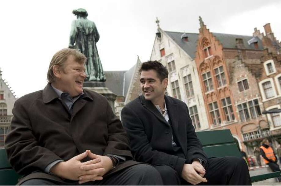 Two hit men (Brendan Gleeson, left, and Colin Farrell) hide out in a medieval Belgium city in the film In Bruges. Photo: Jaap Buitendijk