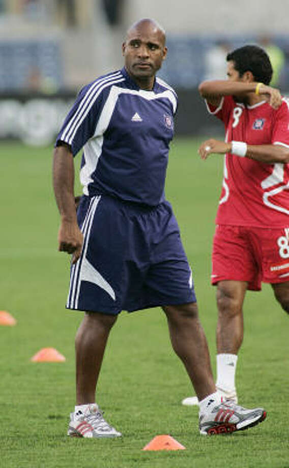 Denis Hamlett (in blue) replaces Juan Carlos Osorio, who left to coach the New York Red Bulls. Photo: Brian Kersey, Chicago Fire